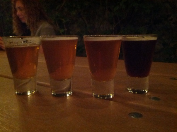 Four tasters, Imperial IPA, Green Bullet, Le Freak, and Grand Cru.