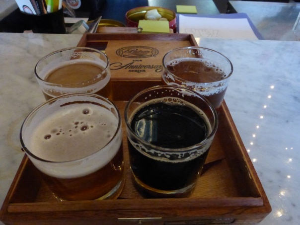 Taster flight. Saison (top left), Hoppy Amber (top right), Hoppy Wheat (bottom left), Coffee Stout (bottom right)